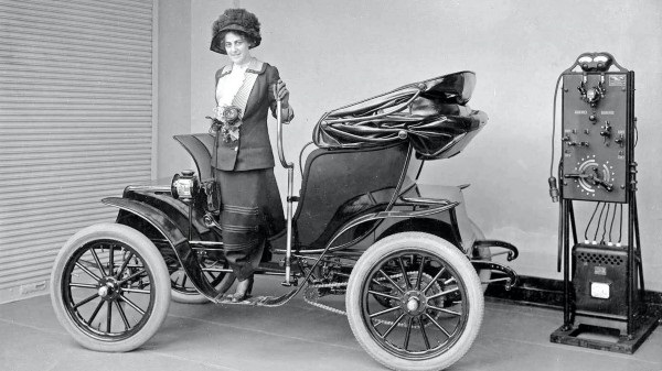 electric-vehicle-woman-charging